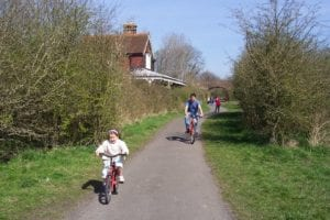 Parent and Child riding bikes on Cuckoo Trail Footpath