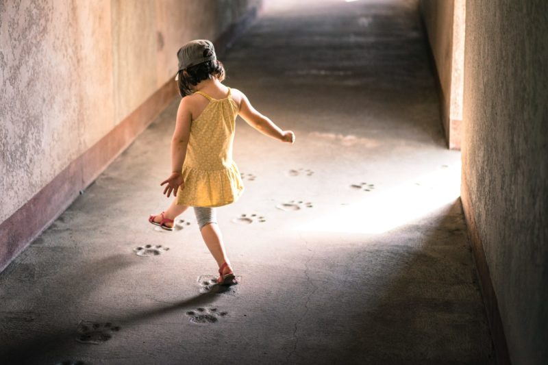 Kid dancing in the light